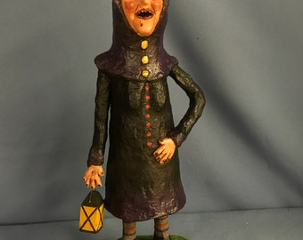 Paper mache sculpted spooky Halloween witch trick or treat figure