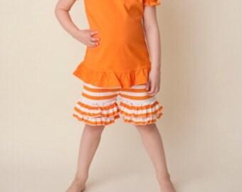 Girls orange and white striped ruffle shorts