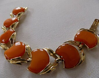 Vintage retro orange thermoset plastic and gold plate cuff bracelet, Coro style