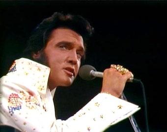Elvis Presley , Elvis on stage in 1973.