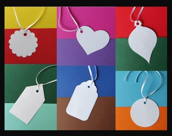 White tags with ribbon attached. 6 shapes. Quality 220 gsm card. Packs of 20.