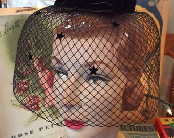 Vintage 1950s 1960s Hat Ringlet Black Velvet With Thick Veiling Has 5 Black Stars Adorning The Front Flowers At The Top