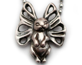 Surreal bunny butterfly sterling silver pendant