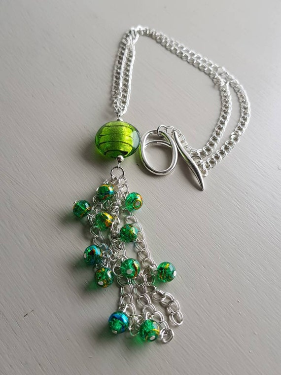 Long green beaded Y statement necklace