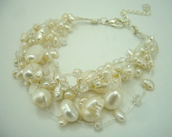 White freshwater pearl,clear crystal hand knotted on silk thread bracelet