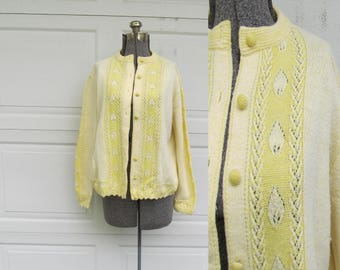 1960s yellow cardigan with leaf trim, covered buttons