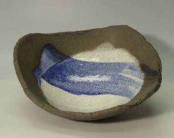 Stoneware shell with artistically designed glaze