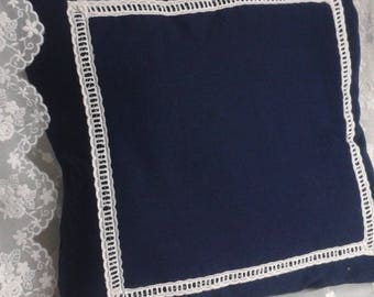 Blue cushion with white embroidered days