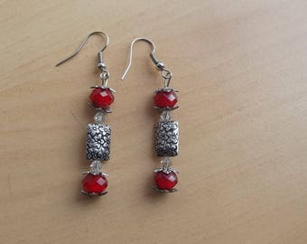 Red stud earrings.