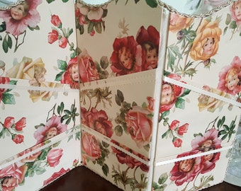 Screen papered in flowers