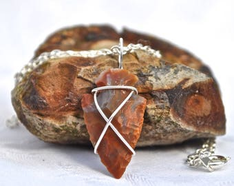 Silver-plated copper wire-wrapped red Elf-shot or Thunderstone pendant.