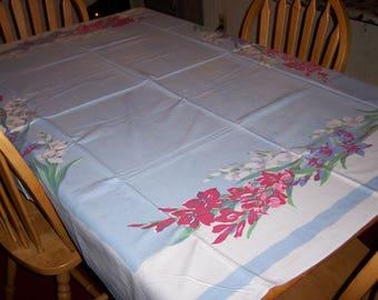 Blue vintage tablecloth with Gladiolas