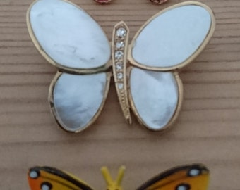 Three vintage butterfly brooches