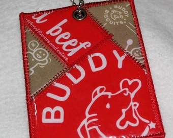 Buddy needs a luggage tag for his pet carrier. Mini Luggage Tag from Recycled Beef Buddy Biscuit Treat Bags