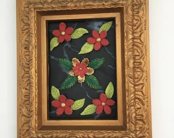 Red ceramic frame with flowers