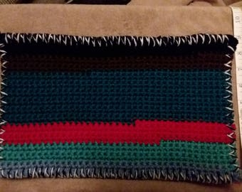 Multi colored casserole pot holder. Front and back are different colors.