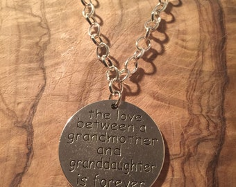"""Charm Bracelet With Silver Plated Chain 7"""" 7/8 length """"the love between a grandmother and a granddaughter is forever"""""""