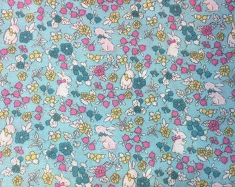 Aqua Cotton Fabric Covered with Bunnies and Flowers