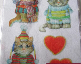Template felt cutting representative of the small kittens and hearts