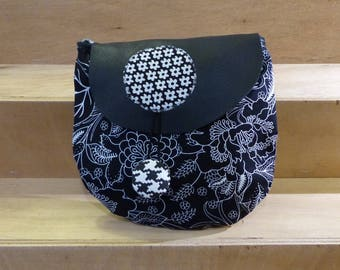 PXS5 fabric bag black with large flowers with a black leather flap