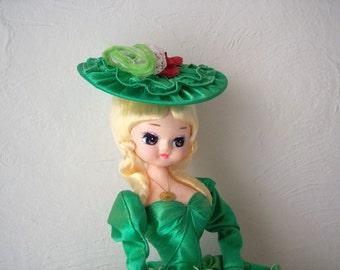 bradley doll - 1960s pose doll - big eyed doll - green dress and hat