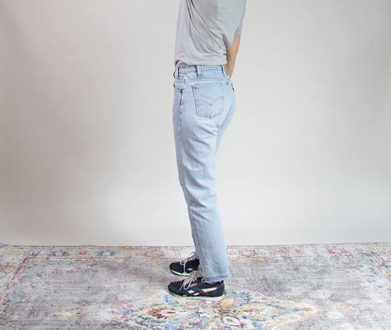 80s Levi's 505 light wash orange tab distressed frayed denim jeans