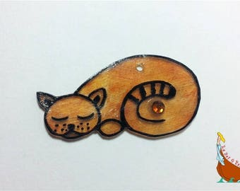 Charm or pendant orange sleeping cat drawing