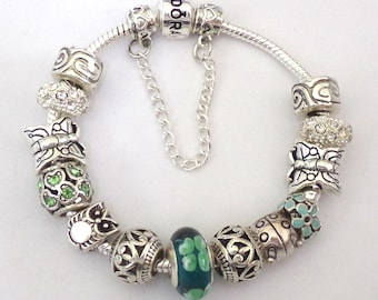 Pandora Style bracelet with silver and turquoise Charms
