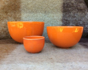 Vintage Scandinavian Art Pottery Group by Master Artist Bjorn Wiinblad rare Vived Orange ceramic 3 Bowls for Rosenthal 1970s