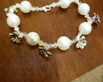 Pearl and flower charm bracelet