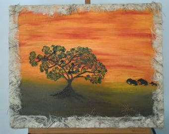 Ethnic painting by hand with elephants on the horizon and romantic sunset that gives the room the warmth of those mysterious places.
