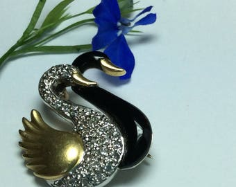 Diamond and enamel Swan brooch in 18ct gold