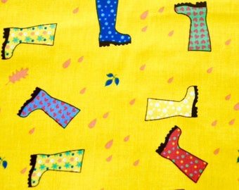 Multi-colored boots on yellow background
