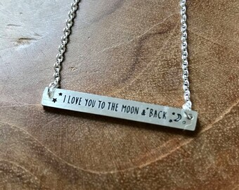 To the moon and back - barnecklace with I love you to the moon and back text. silvertone, trend, hipster, modern, minimal, stainless steel