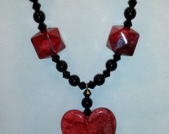 Red heart pendant necklace and earring set.