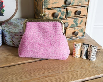 Larger size coin purse in pink Harris Tweed with a pink and apple green floral Liberty lawn lining, and a light bronze coloured metal frame