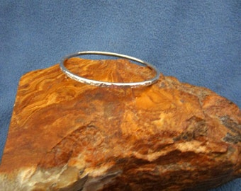 Solid Sterling Silver Bangle Bracelet with Random Hammered Texture on Front and Sides