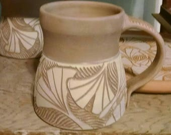 Stoneware Mug with Gikgo Design ashglazed and neutral glaze inside. Made-to-Order
