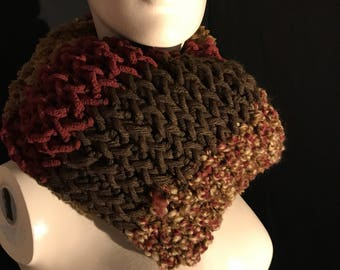 Multi coloured scarf made with many different yarns.