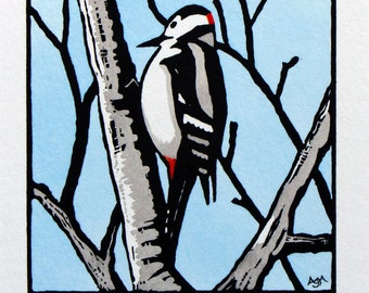 Great Spotted Woodpecker Linocut Print Hand-coloured Limited Edition (blue sky background)