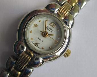 """Vintage lady's watch """" Victoria Rhein"""" silver and gold tone stainlessteel snap band  used watch"""
