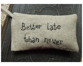 Lavender sachet in linen with embroidered text 'Better late than never'