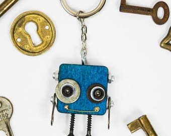 Blue robot keychain with bolts and screws