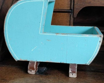Old wooden doll cradle with Hood