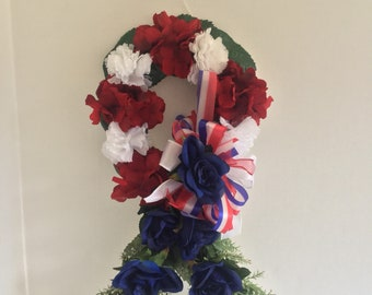 Patriotic ribbon grave decoration, memorial flowers, Floral Memorial, grave marker, in memory of, red white and blue flowers.