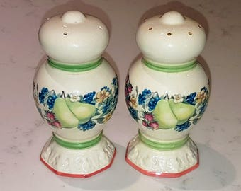 Vintage salt and pepper shakers, ceramic with fruit pattern all around.