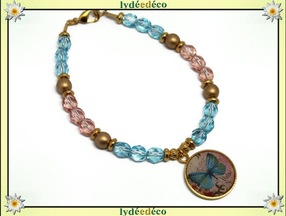 Bracelet resin brass gold 24 carat pink butterfly blue white gold faceted beads