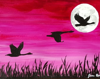silhouette geese in flight in moonlight