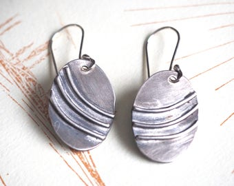Sterling silver oval earrings with 3 curved lines on hand-made ear hooks