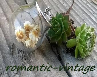 Beautiful round flower decorated glass bottle pendant